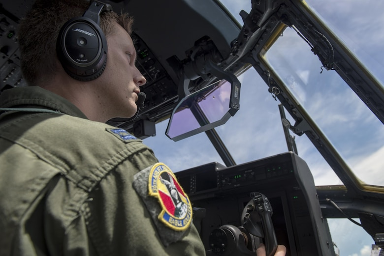A pilot assigned to the 36th Airlift Squadron flies Yokota Air Base's first C-130J Super Hercules operational mission, June 30, 2017, near Manila, Philippines. The mission gave the Airmen the chance to showcase the aircraft's capabilities while transporting cargo. (U.S. Air Force photo by Airman 1st Class Juan Torres)