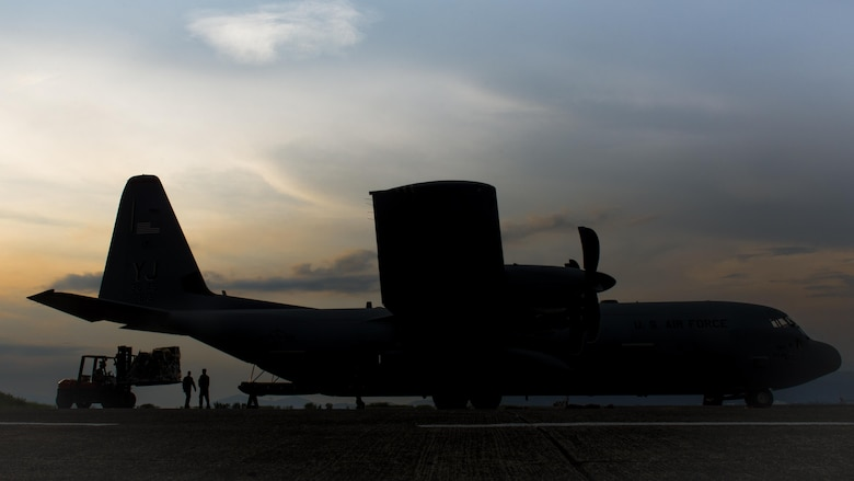 Airmen assigned to the 374th Airlift Wing at Yokota Air Base, Japan, load cargo on to a C-130J Super Hercules during Yokota's first C-130J operational mission, June 30, 2017, at Manila, Philippines. The mission highlighted Yokota's C-130J increased airlift capabilities. (U.S. Air Force photo by Airman 1st Class Juan Torres)