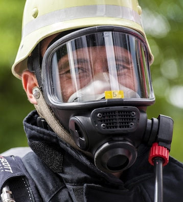 A firefighter poses before racing in a timed obstacle course at the 4th annual Mosel Firefighter Combat Challenge in Ediger-Eller, Germany, June 30, 2017. More than 12 countries, 375 participants and 1200 spectators attended the three day event that encouraged firefighter fitness and demonstrated the rigorous profession to the public. (U.S. Air Force photo by Senior Airman Preston Cherry)