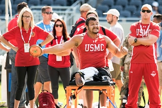 Marine Corps veteran Matthew Grashen competes in the discus event during the 2017 Department of Defense Warrior Games in Chicago, July 3, 2017. The DoD Warrior Games are an annual event allowing wounded, ill and injured service members and veterans to compete in Paralympic-style sports. DoD photo by Roger L. Wollenberg