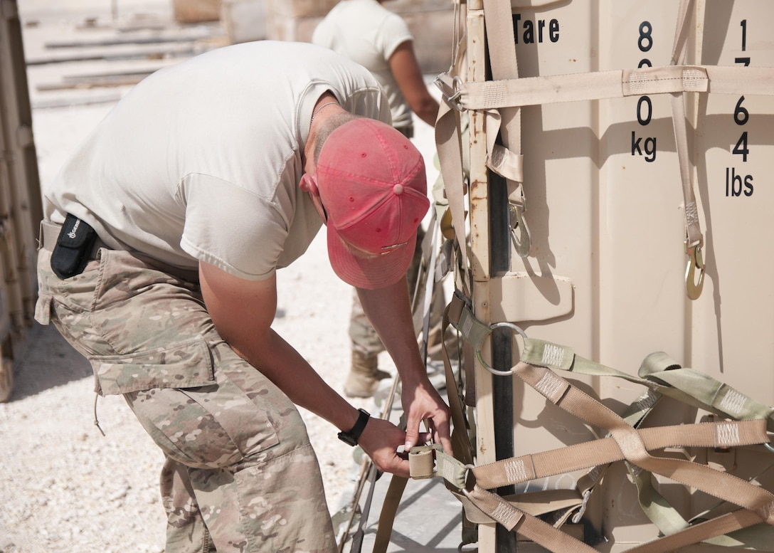 Sgt. Brandon Krieger, of the 824th Quartermaster Company, secures a container with cargo netting for aerial delivery at Al Udeid Air Base, Qatar on April 19, 2017. Aerial delivery operations are essential for getting supplies to troops in the Middle East when conventional means of transportation are not feasible. (U.S. Army photo by Sgt. Jeremy Bratt)