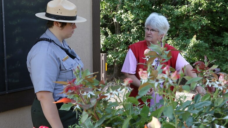 Ranger Shawna Polen (left), volunteer coordinator at Canton Lake, Oklahoma, talks to volunteer Denise Mollohan at the gate to Big Bend Campground, Canton Lake.  Mollohan has been volunteering at Canton Lake for five years with her husband Bob.