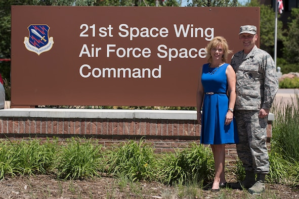 PETERSON AIR FORCE BASE, Colo. – Col. Doug Schiess, 21st Space Wing commander, and his wife, Debbie, prepare for their transition to Washington D.C. after serving as the wing commander since June 2015. Schiess is in command of the Air Force's most geographically separated wing located in eight countries, crossing 13 time zones, and 38 units at 22 locations. Schiess' change of command is scheduled for July 11, 2017. (U.S. Air Force photo by Staff Sgt. Tiffany Lundberg)