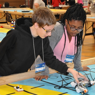 KING GEORGE. Va. (June 28, 2017) - Middle school students use remote-controlled models to solve simulated naval robotic missions at the 2017 Naval Surface Warfare Center Dahlgren Division sponsored STEM Summer Academy, held June 26-30. Camp activities included ten robotic challenges; building a water rocket and determining the optimal fuel loading to maximize height; exploring epidemiology; building and destructively testing a tower from balsa wood with the goal of maximizing the strength to weight ratio; predicting the number of each color of M&Ms in a large bag after compiling statistics on numbers in smaller bags; and building a boat out of foil and straws with the aim of maximizing its cargo carrying capacity.