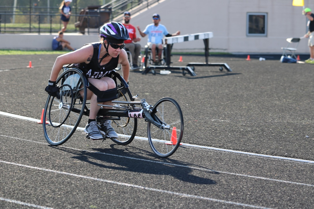 U.S. Army Reserve Staff Sgt. Rachel Salemink, uses perfect technique around the turns during the women's 1500 meter 3.0 racing wheelchair event July 2, at Lane Tech College Prep High School, Chicago, Illinois, during the 2017 Department of Defense Warrior Games. The DOD Warrior Games are an adaptive sports competition for wounded, ill and injured service members and veterans. Approximately 265 athletes representing teams from the Army, Marine Corps, Navy, Air Force, Special Operations Command, United Kingdom Armed Forces, and the Australian Defence Force will compete June 30 – July 8 in archery, cycling, track, field, shooting, sitting volleyball, swimming, and wheelchair basketball. (U.S. Army photo by Robert A. Whetstone)
