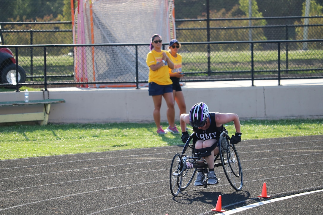 U.S. Army Reserve Staff Sgt. Rachel Salemink, pushes hard toward the finish of the women's 1500 meter 3.0 event July 2, at Lane Tech College Prep High School, Chicago, Illinois, during the 2017 Department of Defense Warrior Games. The DOD Warrior Games are an adaptive sports competition for wounded, ill and injured service members and veterans. Approximately 265 athletes representing teams from the Army, Marine Corps, Navy, Air Force, Special Operations Command, United Kingdom Armed Forces, and the Australian Defence Force will compete June 30 – July 8 in archery, cycling, track, field, shooting, sitting volleyball, swimming, and wheelchair basketball. (U.S. Army photo by Robert A. Whetstone)