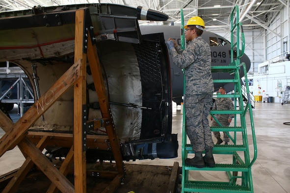 Airman Wilfredo Vargas, 445th Maintenance Squadron, replaces a thrust reverser door on a 445th Airlift Wing C-17 Globemaster III engine here, June 3, 2017.  (U.S. Air Force photo /Tech. Sgt. Patrick O'Reilly)