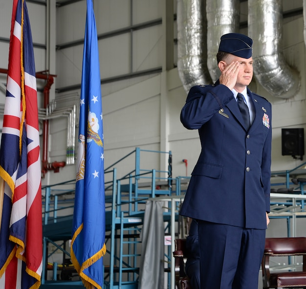 U.S. Air Force Col. Matthew Pollock, 100th Maintenance Group commander, gives his first salute to Airmen at the 100th MXG change of command ceremony July 6, 2017, on RAF Mildenhall, England. Pollock was previously the chief of V-22 Joint Readiness, PMA-275, Patuxent River Naval Air Station, Md. (U.S. Air Force photo by Karen Abeyasekere)