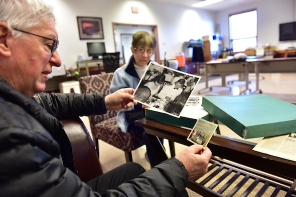 Retired Capt. John Lavrich and his wife Janet look through a box of their wedding photographs at the Niagara Falls Air Reserve Station, Niagara Falls, N.Y. on April 24, 2017. The couple were married on base 50 years ago and returned to commemorate the event. (U.S. Air Force photograph by Staff Sgt. Richard Mekkri)