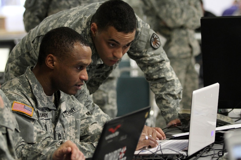 Soldiers assigned to the 780th Military Intelligence Brigade participate in a Cyber Development and Mentorship Exercise to enhance cyber skills at Ft. Meade, Md., April 16, 2014. U.S. Cyber Command photo by Tina Miles