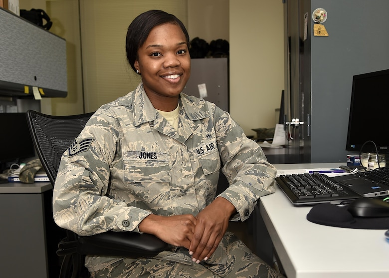 Air Force Staff Sgt. Akina L. Jones, an industrial hygiene and occupational health NCO in charge assigned to the 175th Medical Group, poses for a photo June 30, 2017, at Warfield Air National Guard Base, Md. When Jones is not working on base, she works as a cosmetologist and esthetician. (U.S. Air National Guard photo by Airman Sarah M. McClanahan)