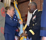Defense Logistics Agency Director Army Lt. Gen. Darrell Williams passes the DLA flag to Air Force Brig. Gen. Linda Hurry as she assumes command of DLA Aviation June 28, 2017 during a ceremony on Defense Supply Center Richmond, Virginia.