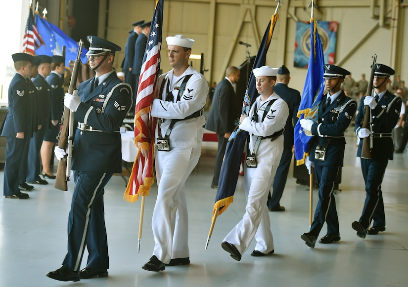 Airmen and Sailors post the colors during the 628th Air Base Wing and Joint Base Charleston change of command ceremony at Nose Dock 2 here, July 6, 2017. Col. Jeffrey Nelson took command from Col. Robert Lyman during the ceremony. U.S. Air Force Maj. Gen. Christopher Bence, U.S. Air Force Expeditionary Center commander, presided over the event.