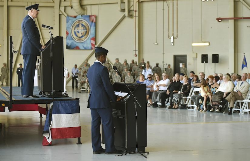 Col. Robert Lyman, 628th Air Base Wing and Joint Base Charleston outgoing commander, bids farewell to his joint team during a change of command ceremony at Nose Dock 2 here, July 6, 2017. Col. Jeffrey Nelson took command from Lyman during the ceremony. Lyman's tenure began in July 2015. He is now scheduled for an assignment to Joint Special Operations Command, Fort Bragg, N.C., where he will be the director of communications.