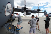 Members of the Minnesota United F.C. toured a 934th Airlift Wing C-130 June 25 after sponsoring participating in a Military Youth Soccer Clinic at the Minneapolis-St. Paul Air Reserve Station. (Photo by Paul Zadach)