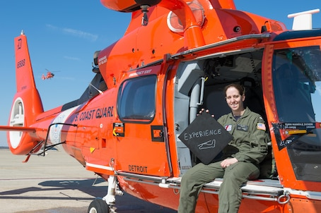 """1. What is your name and what do you do in the Coast Guard? """"Marguerite Champlin, but I go by """"Maggie."""" I'm a pilot in the MH-65D helicopter and one of two Education Services Officers at U.S. Coast Guard Air Station Atlantic City. As a pilot my duties include standing search and rescue duty on a regular basis as one of two pilots in a typical SAR crew. As an ESO I administer mid-term and final exams for personnel in college. I counsel U.S. Coast Guard members on college options and tuition assistance. I am also qualified to administer Federal Aviation Administration exams to pilots and flight mechanics seeking professional qualifications outside of the Coast Guard.""""  2. Describe diversity in a word or two and explain what it means to you. """"I chose """"experience"""" as my word. I grew up in Alabama and before joining the Coast Guard I was a U.S. Navy helicopter pilot. I've travelled and have been stationed all over the world.""""  3. How has your experience and background prepared you to be effective at your job? """"When I transferred to the Coast Guard, I brought with me the diversity of those experiences. There are a lot of Coast Guard service members with prior military experience from other services. This melting pot of backgrounds makes the Coast Guard stronger. """"  4. Tell me a little bit about your life outside of work. """"Life outside of work is pretty simple. I'm either hiking with my husband and our Great Dane or in my sewing room making and/or repairing quilts.""""  U.S. Coast Guard photo by Auxiliarist David Lau"""