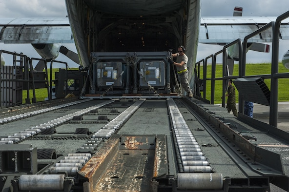 U.S. Air Force Airman 1st Class Ivan Tamez, 733rd Air Mobility Squadron aircraft services specialist, unloads a Japanese Air Self Defense Force C-130 Globemaster taking part in Exercise Keen Sword Oct. 30, 2016, on the flightline at Kadena Air Base, Japan. Keen Sword is a multi-phase exercise which involves multiple bases and branches from across the Pacific theater. (U.S. Air Force photo by Airman 1st Class Nick Emerick /Released)