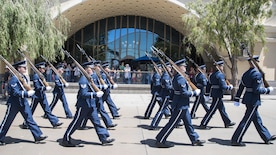 The U.S. Air Force Honor Guard marches throughout Disney's California Adventure Park in Anaheim, Calif., June 28, 2017. In an effort to make a grand appearance among such a diverse audience, the group of 42 Airmen traveled to the Golden State and performed complex routines involving choreographed sequences of weapon maneuvers while maintaining a sense of professionalism and pristine appearance while in uniform. (U.S. Air Force photo by Senior Airman Jordyn Fetter)