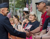 Col. E. John Teichert, 11th Wing and Joint Base Andrews commander, greets an audience member at a Today Show taping near Rockefeller Plaza in New York City, July 4, 2017. Teichert was there in support of his Airmen with the U.S. Air Force Band ceremonial brass ensemble and Honor Guard color team participating in Independence Day celebrations in New York. (US Air Force Photo by Airman 1st Class Gabrielle Spalding)