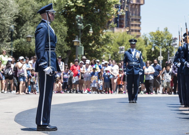 Capt. Riley Platt, U.S. Air Force Honor Guard Drill Team commander, directs his Airmen at Disney's California Adventure Park in Anaheim, Calif., June 28, 2017. In order to perform across the country and with collective accuracy, the team practiced the routine approximately six times together before leaving Joint Base Anacostia-Bolling, District of Colombia, and prior to the start of each performance day on the trip. (U.S. Air Force photo by Senior Airman Jordyn Fetter)