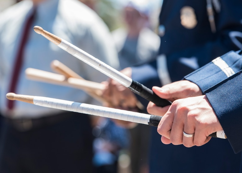 Airman 1st Class Mason Yu, U.S. Air Force Honor Guard drummer, keeps time with drumsticks during a performance at Disney's California Adventure Park in Anaheim, Calif., June 28, 2017. In order to perform across the country with collective accuracy, the team practiced the routine approximately six times together before leaving Joint Base Anacostia-Bolling, District of Columbia, and prior to the start of each performance day on the trip. (U.S. Air Force photo by Senior Airman Jordyn Fetter)