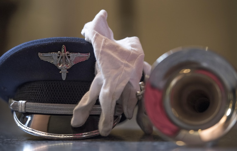 A U.S. Air Force band member's hat, glove and trumpet rest on the floor near Rockefeller Plaza in New York City, July 4, 2017. The U.S. Air Force Band ceremonial brass ensemble and an Honor Guard color team were there to represent the men and women of the U.S. Air Force during a taping of the Today Show and opening ceremonies at Yankee Stadium for a Yankees baseball game. (US Air Force Photo by Airman 1st Class Gabrielle Spalding)