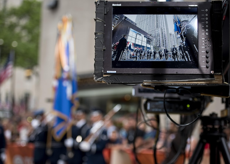 The U.S. Air Force Band ceremonial brass ensemble and Honor Guard color team appear on a camera screen during a Today Show taping near Rockefeller Plaza in New York City, July 4, 2017. They were there to represent the men and women of the U.S. Air Force during Independence Day celebrations in New York. Following the Today Show taping, they performed during the opening ceremonies at Yankee Stadium for a Yankees baseball game. (US Air Force Photo by Airman 1st Class Gabrielle Spalding)