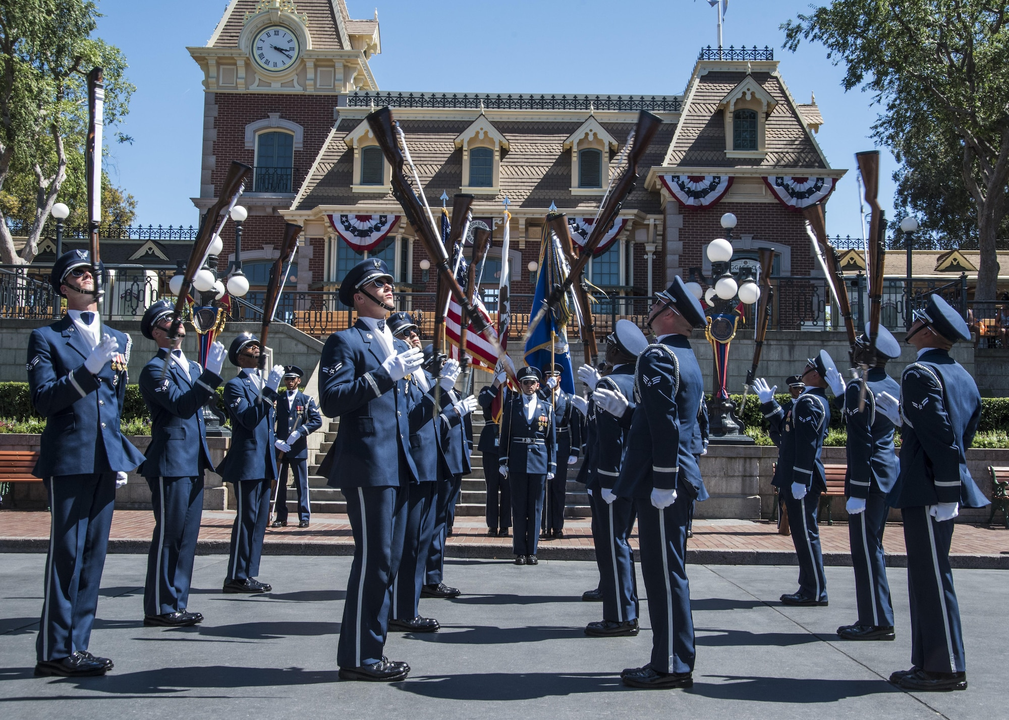 """The U.S. Air Force Honor Guard Drill Team performs at Disneyland in Anaheim, Calif., June 28, 2017. The """"Ambassadors in Blue"""" demonstrated drill routines during their recent tour of Southern California where they also performed at Sea World, Disney's California Adventure Park, and Mission Beach from June 27 to July 1. (U.S. Air Force photo by Senior Airman Jordyn Fetter)"""