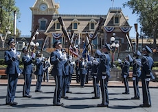 "The U.S. Air Force Honor Guard Drill Team performs at Disneyland in Anaheim, Calif., June 28, 2017. The ""Ambassadors in Blue"" demonstrated drill routines during their recent tour of Southern California where they also performed at Sea World, Disney's California Adventure Park, and Mission Beach from June 27 to July 1. (U.S. Air Force photo by Senior Airman Jordyn Fetter)"