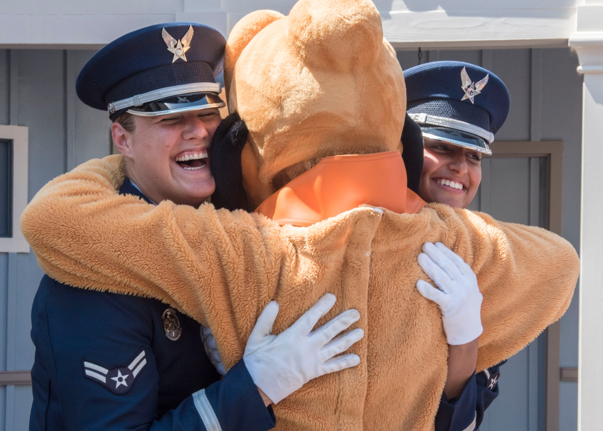 Airman 1st Class Alyssa VanGorder, left, and Airman Daniella Bejarano, right, U.S. Air Force Honor Guard ceremonial guardsmen, hug the Disney character Goofy at Disneyland in Anaheim, Calif., June 29, 2017. In order to perform across the country with collective accuracy, the team practiced the routine approximately six times together before leaving Joint Base Anacostia-Bolling, District of Columbia, and prior to the start of each performance day on the trip. (U.S. Air Force photo by Senior Airman Jordyn Fetter)