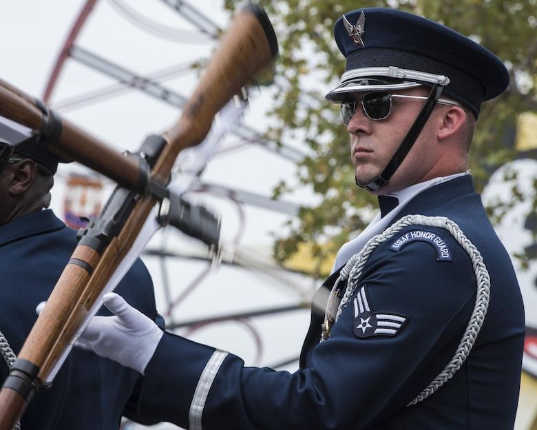 Senior Airman Rigby Carter, U.S. Air Force Honor Guard Drill Team ceremonial guardsman, performs a rifle maneuver at Disney's California Adventure Park in Anaheim, Calif., July 1, 2017. The team develops new performances every year at Keesler Air Force Base, Miss., then proceeds to share it with the world during various outreach events until the next year. (U.S. Air Force photo by Senior Airman Jordyn Fetter)