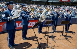 The U.S. Air Force Band ceremonial brass quintet plays the national anthem during opening ceremonies at a New York Yankees baseball game in New York City, July 4, 2017. A U.S. Air Force Honor Guard color team was also there to present colors for the national anthem. (US Air Force Photo by Airman 1st Class Gabrielle Spalding)
