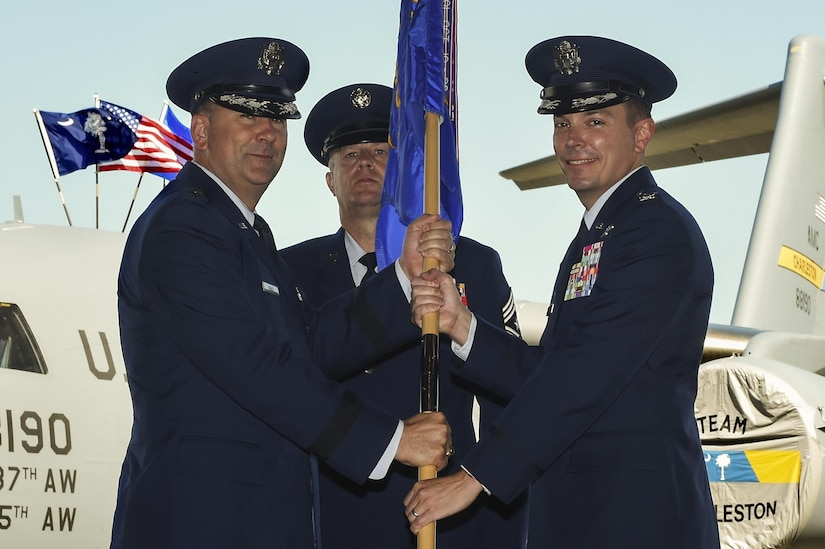 Col. Jeffrey Nelson, right, incoming 628th Air Base Wing and Joint Base Charleston commander, assumed command from Maj. Gen. Christopher Bence, left, U.S. Air Force Expeditionary Center commander, at Nose Dock 2 here, July 6. Nelson accepted command from Col. Robert Lyman, outgoing 628th ABW and Joint Base Charleston commander.