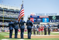U.S. Air Force Honor Guard color team members stand at attention during the playing of the national anthem at Yankees Stadium in New York City, July 4, 2017. The U.S. Air Force Band ceremonial brass quintet and color team were there to represent the men and women of the U.S. Air Force during opening ceremonies at a Yankees baseball game. (US Air Force Photo by Airman 1st Class Gabrielle Spalding)