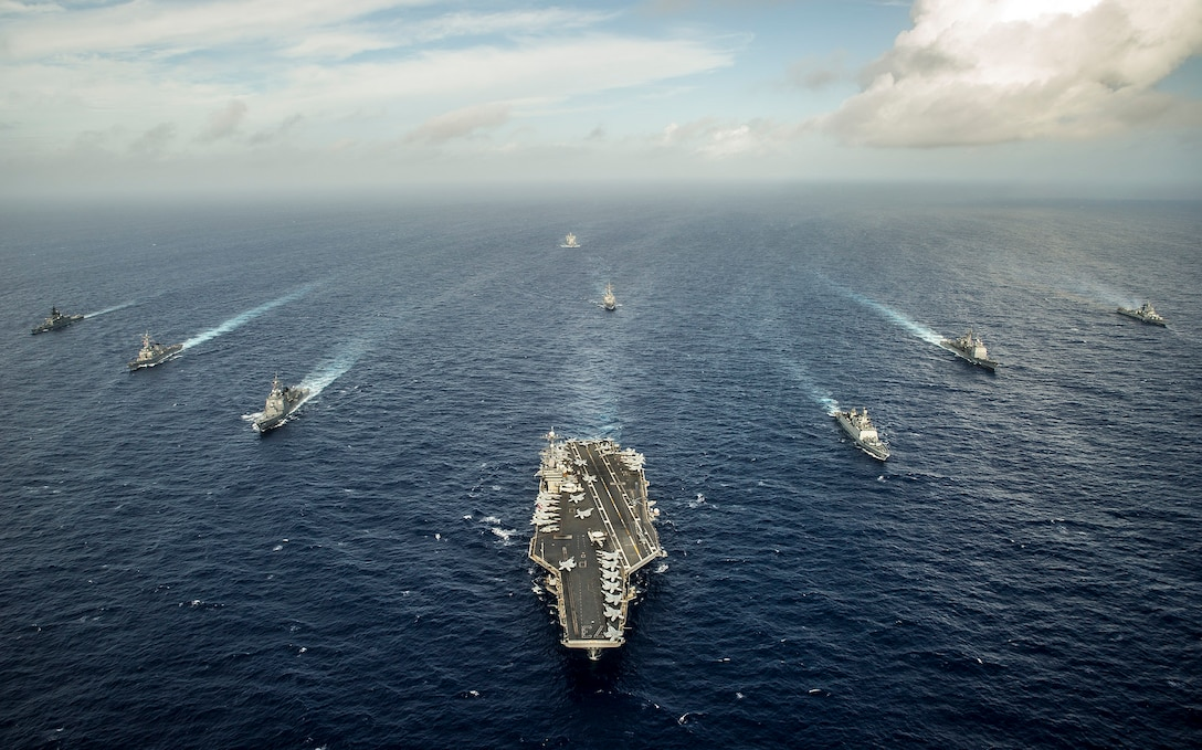 n this file photo, ships from the U.S. and Indian navies, and Japan Maritime Self-Defense Force steam in formation during Malabar 2014.