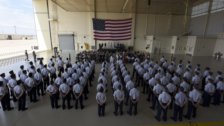U.S. Air Force Airmen assigned to the 317th Airlift Group stand in formation during the 317th Airlift Wing activation ceremony at Dyess Air Force Base, Texas, July 6, 2017. In addition to Team Dyess members, civic leaders, community partners, distinguished guests and family members attended the deactivation of the 317th AG and activation of the 317th AW. (U.S. Air Force photo by Senior Airman Kedesha Pennant)