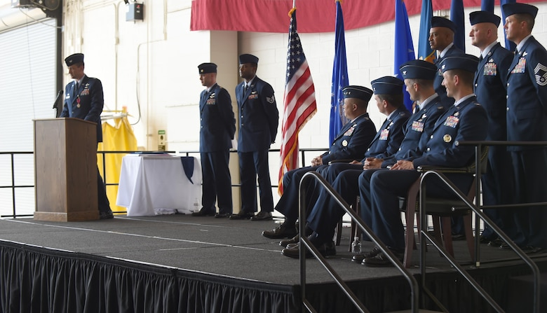 U.S. Air Force Col. Stephen Hodge, 317th Airlift Group commander, speaks to Dyess Airmen, family members and civic leaders at Dyess Air Force Base, Texas, July 6, 2017. Hodge was awarded the Legion of Merit for his contributions and accomplishments while commanding the 317th AG and then relinquished command to Col. David Owens. (U.S. Air Force photo by Senior Airman Alexander Guerrero)