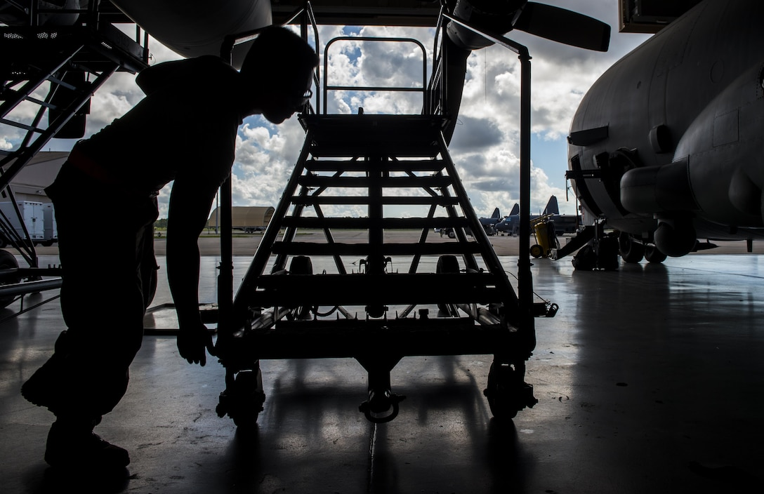 Airman 1st Class James Gaona, an aerospace propulsion journeyman with the 1st Special Operations Aircraft Maintenance Squadron, prepares a stand before conducting maintenance on an AC-130U Spooky gunship at Hurlburt Field, Fla., July 6, 2017. Aerospace propulsion technicians test, maintain and repair AC-130U engines, preparing them to execute the mission any time, any place. (U.S. Air Force photo by Airman 1st Class Joseph Pick)