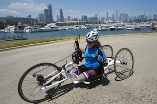 Air Force veteran Heather Carter powers a handcycle during the 2017 Department of Defense Warrior Games in Chicago, July 6, 2017. The Warrior Games are an annual event allowing wounded, ill and injured service members and veterans to compete in Paralympic-style sports. DoD photo by EJ Hersom