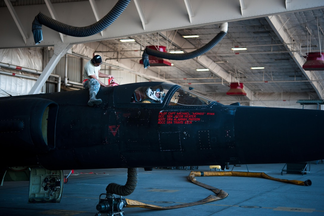 SrA Howard Reyes, 9th Aircraft Maintenance Squadron avionics, removes the upper cooling hose off of a U-2 Dragon Lady that has been prepped for a high altitude flight at Beale Air Force Base, Calif., June 20, 2017. U-2s are home based at the 9th Reconnaissance Wing at Beale AFB Calif., but are rotated to operational detachments worldwide.(U.S. Air Force photo by Airman 1st Class Justin Parsons/released)