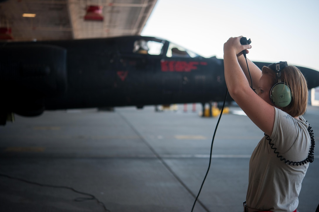 Airman 1st Class Dedrie Flowers, 9th Air Maintenance Squadron crew chief, gives the signal to apply engine start air to the U-2 Dragon Lady at Beale Air Force Base, Calif., June 20, 2017. The U-2 is a single-seat, single-engine, high-altitude/near space reconnaissance and surveillance aircraft providing signals, imagery, and electronic measurements and signature intelligence. (U.S. Air Force photo by Airman 1st Class Justin Parsons/released)