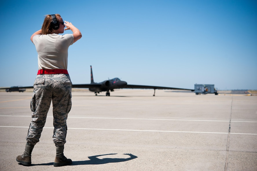 Airman 1st Class Dedrie Flowers, 9th Air Maintenance Squadron crew chief, marshals in a U-2 Dragon Lady for aircraft recovery at Beale Air Force Base, Calif., June 20, 2017. While on the ground, U-2 pilots rely on their chase car to guide and correct their direction.