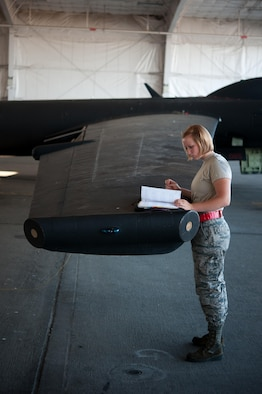 Airman 1st Class Dedrie Flowers, 9th Air Maintenance Squadron crew chief, reviews aircraft forms for serviceability during preparations for a high altitude flight at Beale Air Force Base, Calif., June 20, 2017. Crew chiefs are responsible for ensuring that the squadrons U-2's are mechanically ready for scheduled missions. (U.S. Air Force photo by Airman 1st Class Justin Parsons/released)