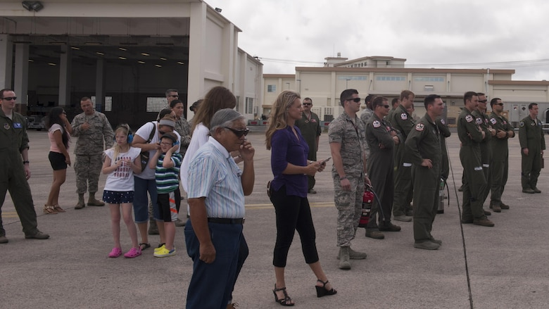 Missy Cornish, wife of U.S. Air Force Brig. Gen. Barry Cornish, 18th Wing commander, and members from Team Kadena await the F-15 piloted by Barry June 29, 2017, at Kadena Air Base, Japan.  Members from the wing and other distinguished visitors traditionally await the aircraft as a part of the final flight. (U.S. Air Force photo/ Airman 1st Class Greg Erwin)