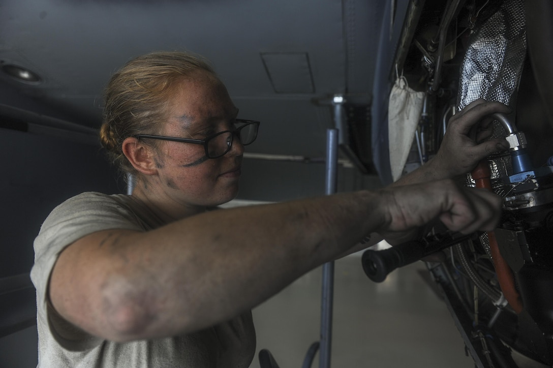 Senior Airman Maggie Jakaitis, an aerospace propulsion journeyman with the 1st Special Operations Aircraft Maintenance Squadron, safety wires a fuel nozzle on an AC-130U Spooky gunship at Hurlburt Field, Fla., July 6, 2017. Aerospace propulsion technicians test, maintain and repair AC-130U engines, preparing them to execute the mission any time, any place. (U.S. Air Force photo by Airman 1st Class Rachel Yates)