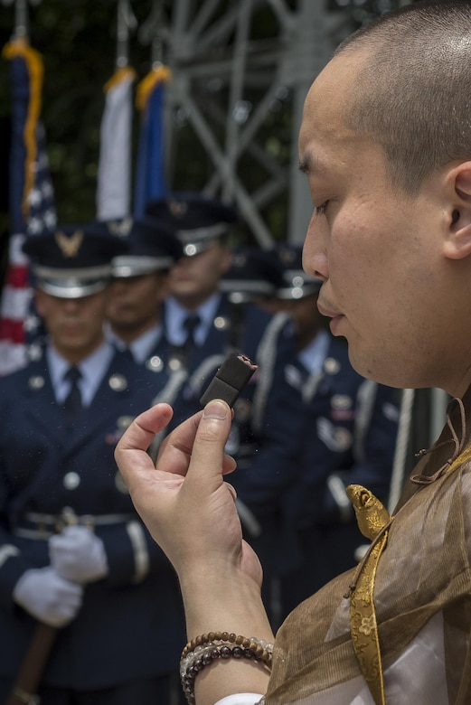 A Buddhist monk makes initial preparations for a B-29 Memorial Ceremony, June 24, 2017, at Shizuoka City, Japan. During the ceremony; flowers, incense and prayers were offered to the American B-29 aircrew and Japanese civilian lives lost. (U.S. Air Force photo by Airman 1st Class Juan Torres)