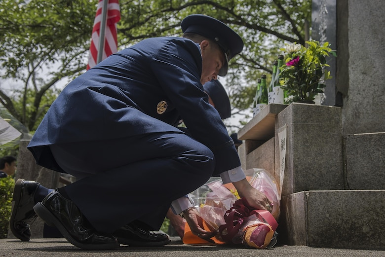 Col. Sergio J. Vega Jr., 374th Airlift Wing vice commander, places flowers on a memorial honoring thousands of Japanese civilians who died in World War II during a B-29 bombing raid, June 24, 2017, at Shizuoka City, Japan. Since 1972 Yokota Air Base Airmen have volunteered their time to take part in a US-Japan joint memorial service to pay respect to those who lost their lives on June 19, 1945, during a World War II air raid over Shizuoka. (U.S. Air Force photo by Airman 1st Class Juan Torres)