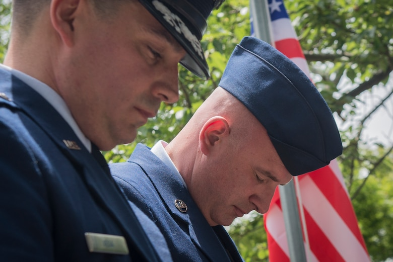 Col. Sergio J. Vega Jr., 374th Airlift Wing vice commander, left, and Chief Master Sgt. Christopher M. Yevchak, 374 AW command chief master sergeant, pay their respects to the victims of a U.S. Army Air Forces' B-29 bombing raid during World War II, June 24, 2017, at Shizuoka City, Japan. Since 1972, Yokota Air Base Airmen have volunteered their time to take part in a US-Japan joint memorial service to pay respect to those who lost their lives on June 19, 1945, during a World War II air raid over Shizuoka. (U.S. Air Force photo by Airman 1st Class Juan Torres)