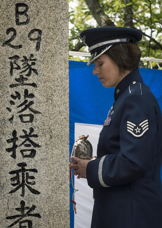 Staff Sgt. Joanne Griffin, U.S. Air Force Band of the Pacific vocalist, pauses for a moment of silence after pouring bourbon from the Blackened Canteen during a B-29 Memorial Ceremony, June 24, 2017, at Shizuoka City, Japan. Since 1972, Yokota Air Base Airmen have volunteered their time to take part in a US-Japan joint memorial service to pay respect to those who lost their lives on June 19, 1945, during a World War II air raid over Shizuoka. (U.S. Air Force photo by Airman 1st Class Juan Torres)