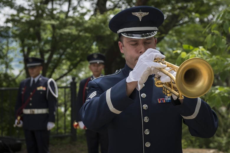 Senior Airman Benjamin Paille, U.S. Air Force Band of the Pacific trumpet player, plays Taps during a B-29 Memorial Ceremony, June 24, 2017, at Shizuoka City, Japan. Since 1972, Yokota Air Base Airmen have volunteered their time to take part in a US-Japan joint memorial service to pay respect to those who lost their lives on June 19, 1945, during a World War II air raid over Shizuoka. (U.S. Air Force photo by Airman 1st Class Juan Torres)